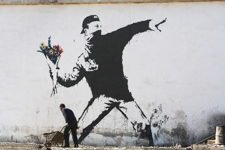 Banksy graffitista strada cinema